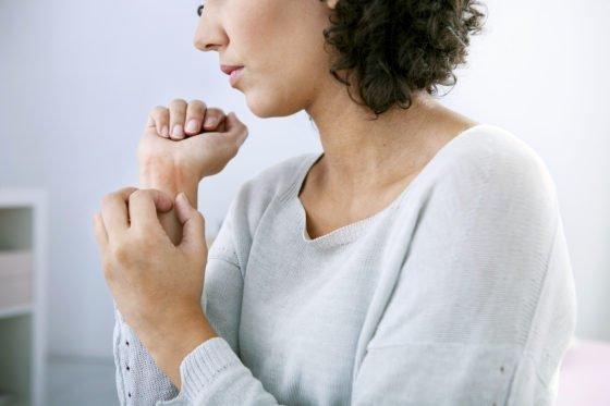 scratching eczema skin on the wrist