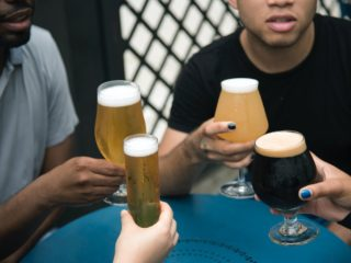 friends gathering having glasses of beer